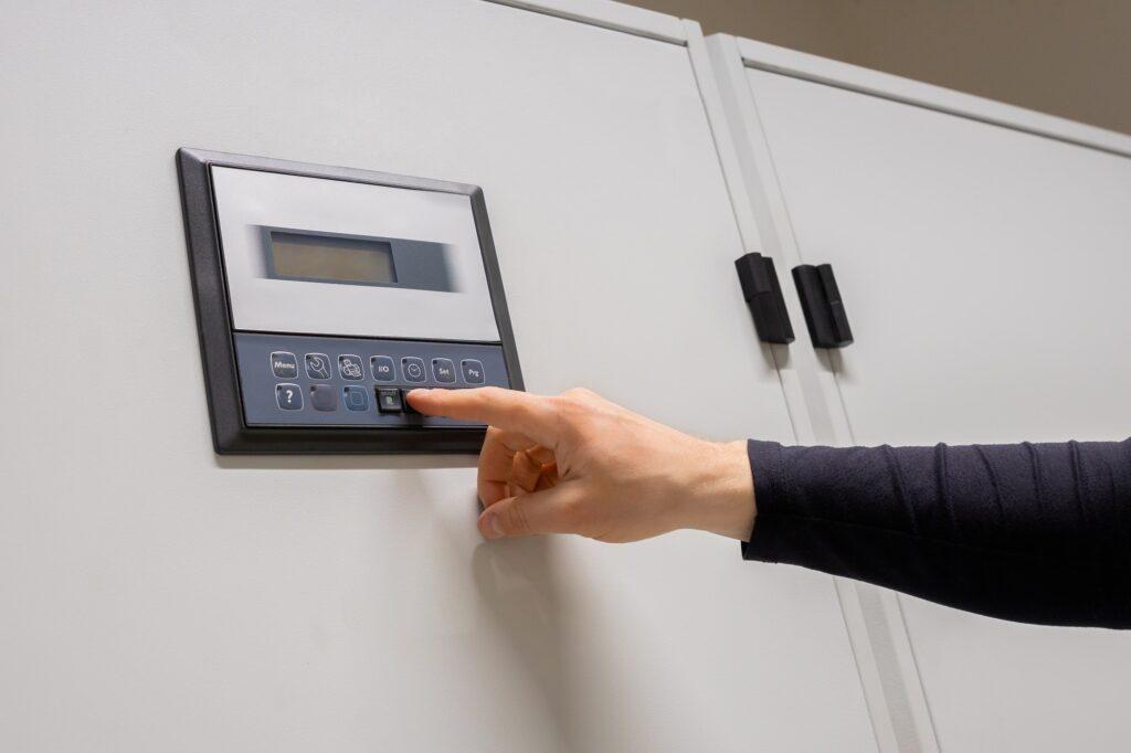 Professional Engineer Adjusting Air Conditioner In Datacenter